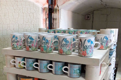 Mothers Day Mugs with Fathers Day Mugs coming out of the kiln
